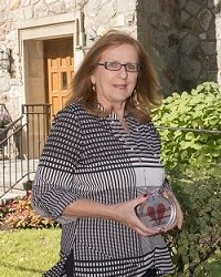 "Marcelle Kecman Wins ""Caring Beyond"" Award"